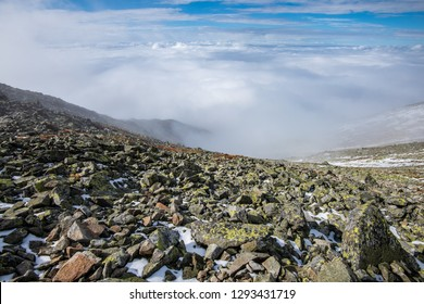 mountain peak view from Krivan in slovakia. mountains covered in winter snow and low clouds with naked rocks