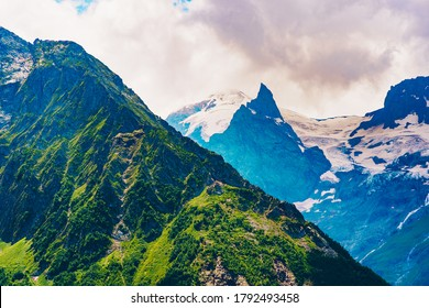 Mountain peaks against cloudy sky. Peaks of magnificent rocks located against bright cloudy sky on sunny day in nature