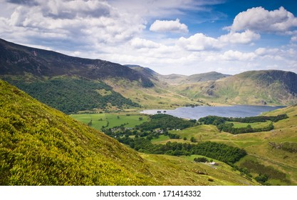 Mountain peaks and blue sky in Eskdale valley, Lake District, UK.