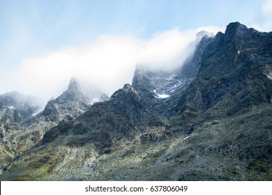 Mountain peaks with fog and snow