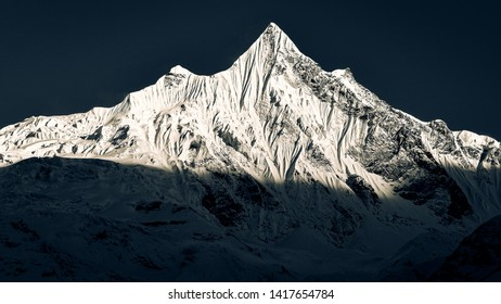 Mountain peaks with glaciers and snow in dark monochrome style, Annapurna region in Himalayas, Nepal, Asia