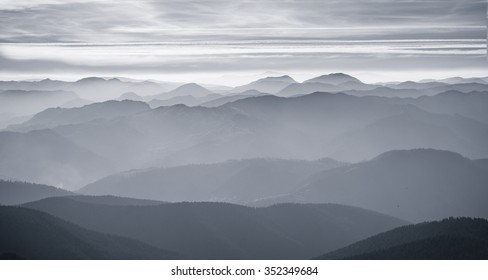 mountain peaks in haze, black and white