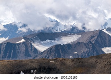 Mountain peaks obscured by clouds in Kluane National Park, Yukon, Canada