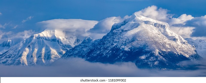 Mountain peaks panorama with fog in winter, Glacier National Park, Montana