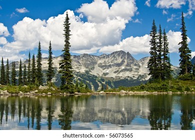 Mountain peaks reflecting off the water in nearby pond