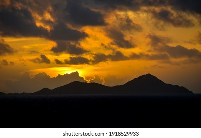 Mountain peaks sunset sky clouds. Sunset mountain sky clouds. Sunset mountain peaks silhouettes. Mountain silhouettes peaks on cloudy sky - Shutterstock ID 1918529933