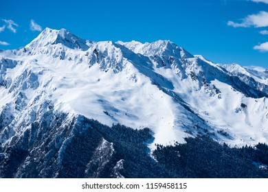 Mountain peaks in winter with snow and forest near Saint Lary Soulan in the french Pyrenees, France