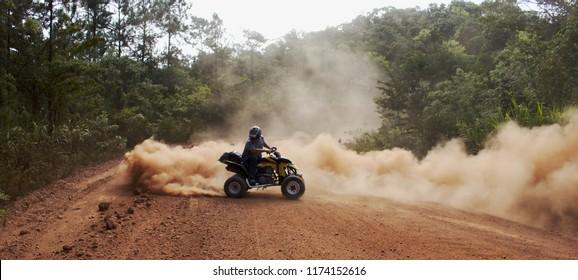 Mountain Pine Ridge, Belize - August 2, 2018: Kenton Reimer kicks up some dust on his Suzuki LTZ400  atv.
