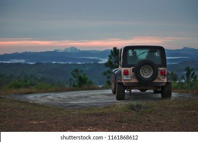 Mountain Pine Ridge, Belize - June 17, 2018 Ely Penner parks his Jeep Wrangler while taking a break from exploring.
