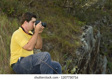 Mountain Pine Ridge, Belize September 9, 2018 Ely Penner photographing the view from a mountain