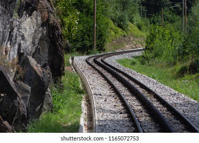 Mountain railway with additional rail for cogwheel,