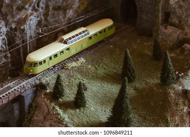 Mountain railway with vintage train on the miniature model.