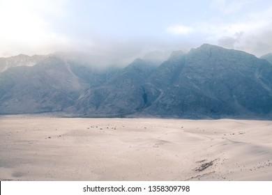 Mountain range in the fog. Katpana Cold Desert at Sarfaranga, Skardu. Gilgit Baltistan, Pakistan.