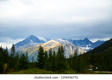 Mountain range of Kootenay National Park with yellow leaves and Kootenay Highway in Autumn, Canadian Rockies, British Columbia, Canada