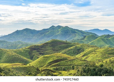Mountain range landscape under morning sky and cloud.