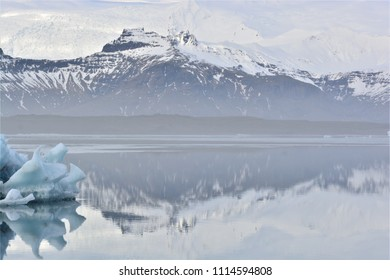 A mountain range next to a lake in Iceland