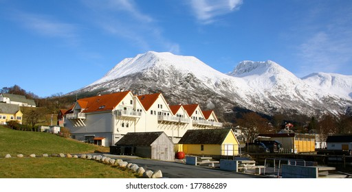 Mountain Range over Rosendal Buildings and Green Grass, Norway