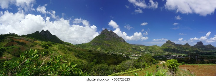 Mountain range Panorama in Mauritius in summer over blue sky