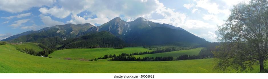 mountain range panorama photo, meadows in foreground, photo taken in Slovakia