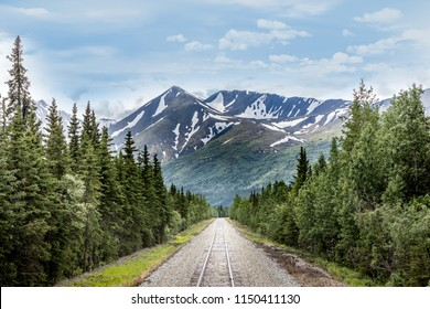Mountain range and railroad track in Denali National Park Alaska