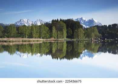 Mountain range reflected in the water of a mountain lake