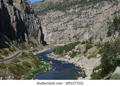 Mountain Range and River - Mountains peaks and railroad tracks along the Wind River Scenic Byway in Wyoming.