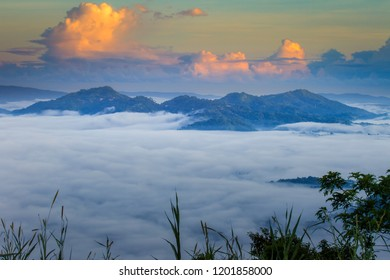 Mountain range at sunrise with beautiful clouds and cloud inversion