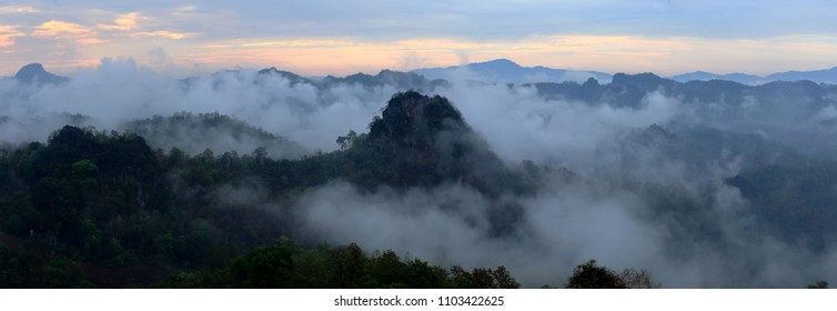 mountain range tropical rainforest canopy at northern of Thailand with more mist and cloud background sky