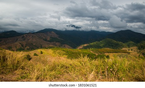 mountain range tropical rainforest canopy at Nan Province of Thailand with more mist and cloud background sky ,rainyday