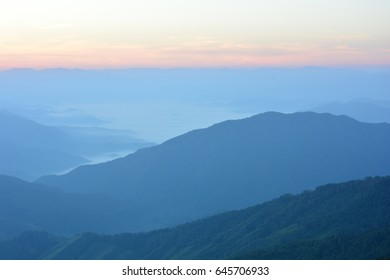 Mountain ranges in the misty morning of northern Thailand, Nan province.