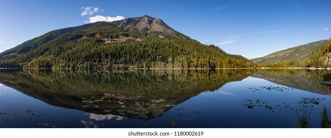 A mountain is reflected in Griffin Lake British Columbia