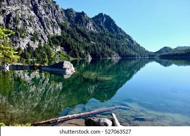 Mountain reflection in Snow Lake. Enchantment Lakes Basin. Leavenworth. Seattle. WA. USA.