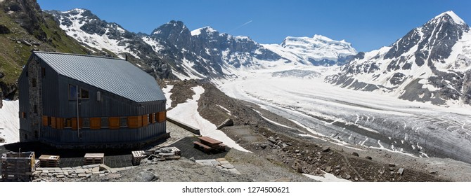 Mountain refuge Panossière with on the background Glacier de Corbassière and mountain Grand Combin (Fionnay, Switzerland)