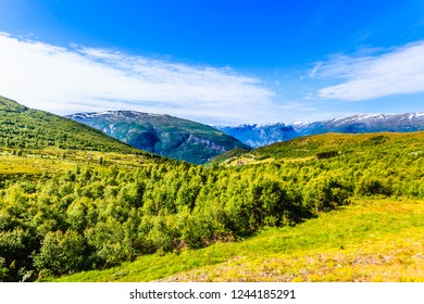 Mountain region between Aurland and Laerdal in Norway. Green summer landscape. National tourist scenic route Aurlandsfjellet.