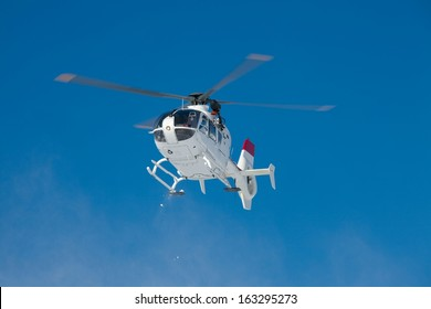 Mountain rescue helicopter against clear blue sky