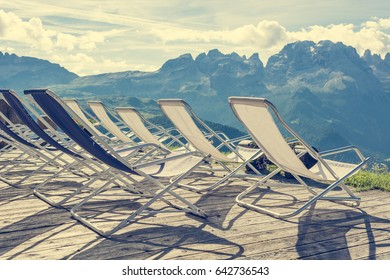 Mountain resort terase with empty chairs.
