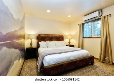 Mountain retreat calming small bedroom with mural in purple tones and white bedding.