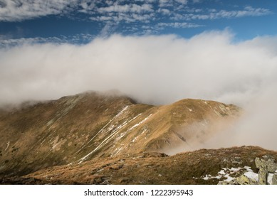 mountain ridge between Skalka and Kotliska hill from Skalka hill in Nizke Tatry mountains in Slovakia during autumn day with blue sky and clouds