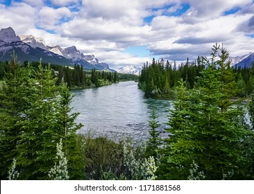 Mountain ridge and Bow River along the Three Sisters Pathway Trail in Canmore, Alberta, Canada.