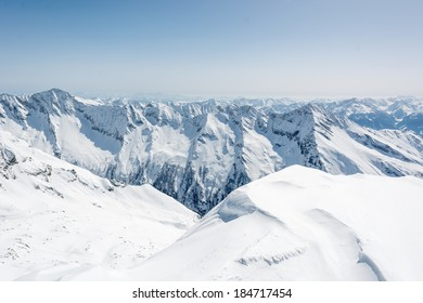 Mountain ridge covered with snow, view from Ankogel, Austria
