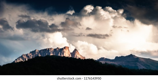 Mountain ridge and dramatic cloudy sky during sunset