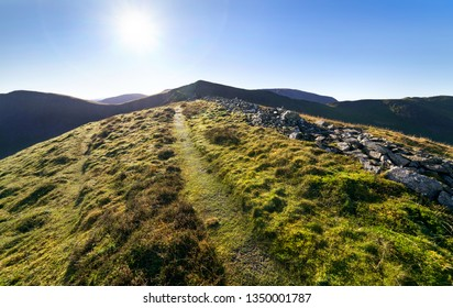 Mountain ridge leading to Ladyside Pike and Hopegill Head on a sunny day in the English Lake District, UK.