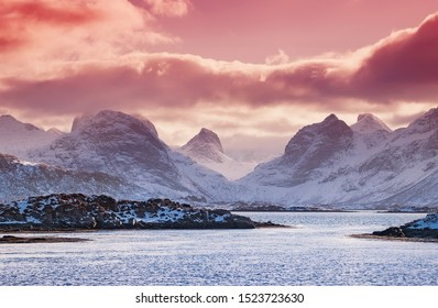 Mountain ridge near the ocean. Beautiful natural landscape in the Norway. High rocks and clouds on peaks. Norway travel - image