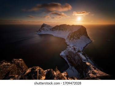 Mountain ridge of Vaeroy island at snowy winter in sunset, Lofoten