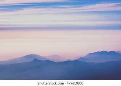 mountain ridges with scenic heat haze by early morning in Japan