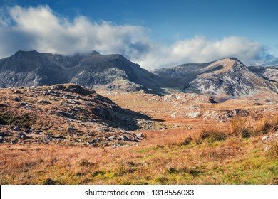 mountain risge capped in cloud on warm autumnal day. Snowdonia National Park in North Wales, UK