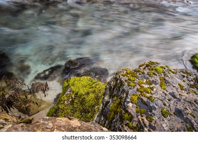 Mountain river in Abkhazia. Rocks and moss. Silky smooth stream flowing by the gorge.