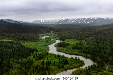 Mountain river among the green forest. National park Yugyd-Va, Polar Ural mountains, Russia.