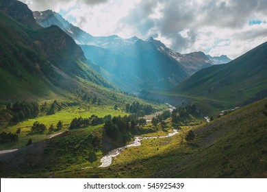 Mountain river Baksan, ravine Adyr-Su, Elbrus area, Greater Caucasus Range. Elbrus, mountains in summer. Greater Caucasus Mountains from Mount Elbrus