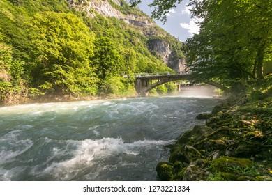 Mountain river bridge in Abkhazia. River bridge in Abkhazia mountains. Abkhazia mountain river bridge view